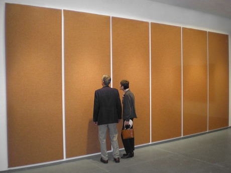 Prison Uniforms, 2007 10x23 feet in six vertical panels  Depicts 2.3 million folded prison uniforms, equal to the number of Americans incarcerated in 2005. The U.S. has the largest prison population of any country in the world.
